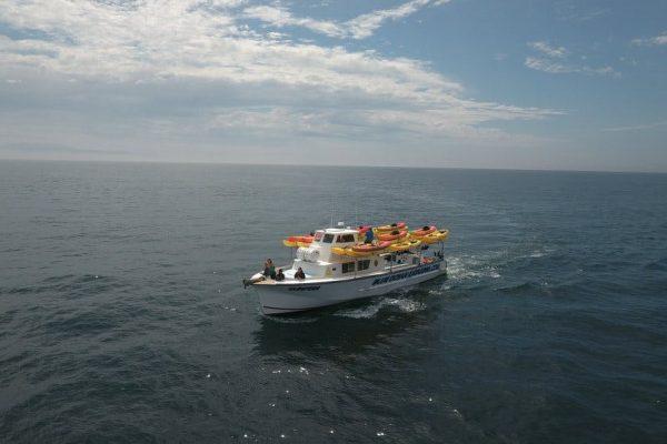 PV sunfish loaded with kayaks