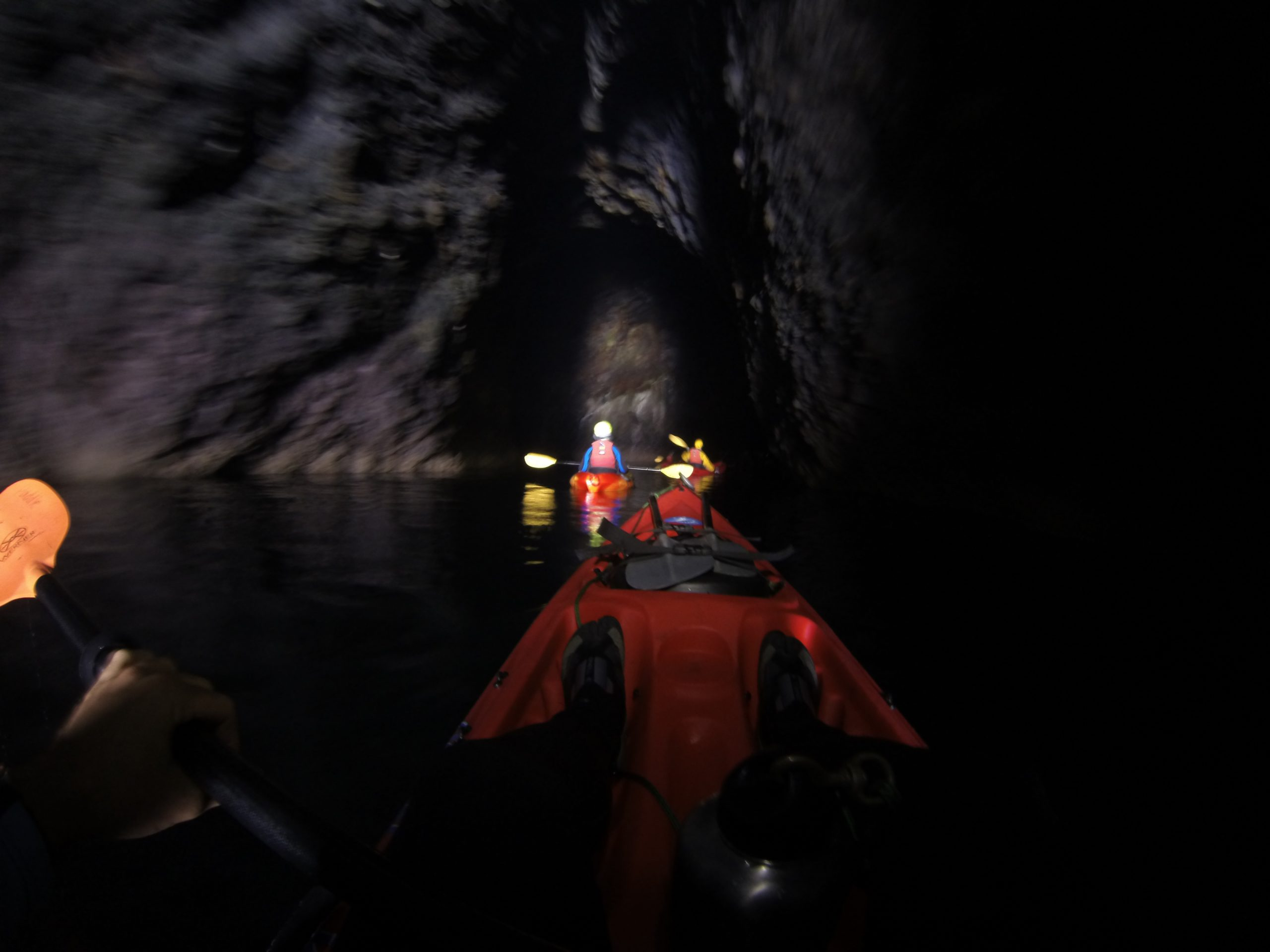 kayakers in a cave