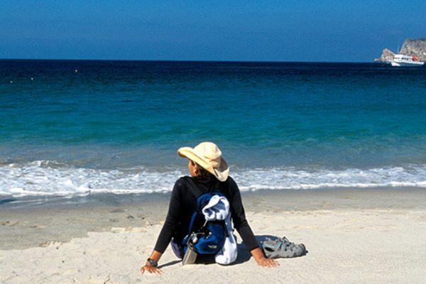 customer enjoying the sandy beach