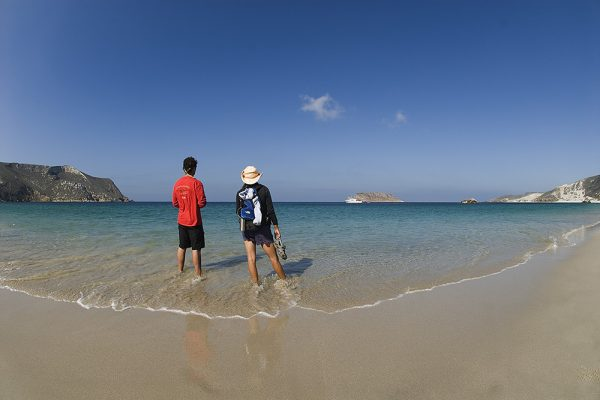 2 people standing on a desolate beach on the Channel Islands
